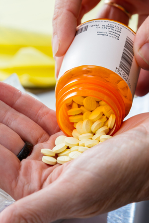 close up of a hand handling prescriptions pills as a concept 写真素材 - 101348659