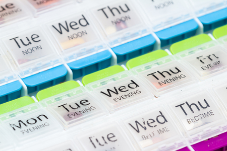 close up of an organizer for a daily regime of prescriptions drugs