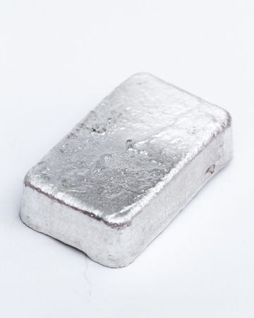Close up of a 10 gram bar of poured silver as a precious metal holding