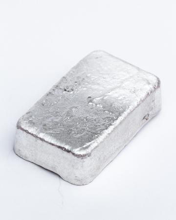Close up of a 10 gram bar of poured silver as a precious metal holding 免版税图像 - 113577403