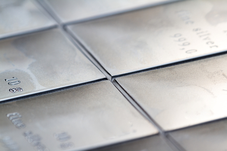 Close up of a fine silver bar stamped in sections and measure din grams