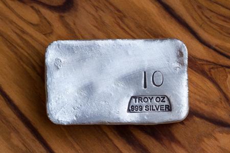 Close up of a 10 gram bar of poured silver as a precious metal holding Standard-Bild - 113584647