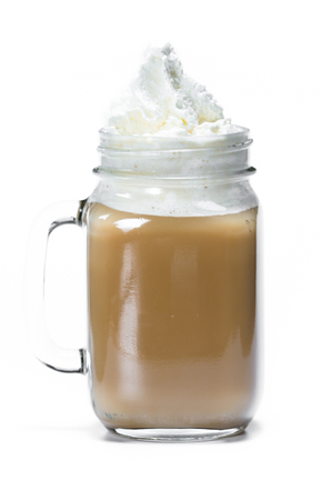fresh brewed coffee served with irish cream then topped with whipped cream isolated on a white