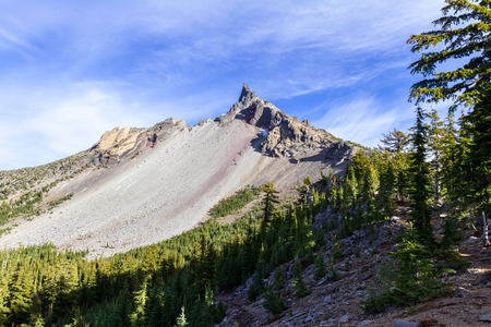Beautiful view of mount  Thielsen from the trail with a green forest in the foreground