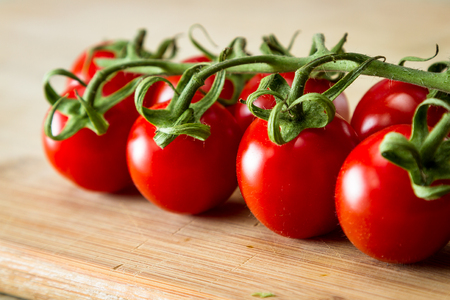 close up of a group of vine ripened strawberry tomatoes with a vibrant red color Reklamní fotografie