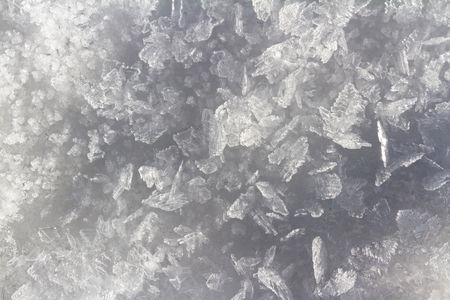 close up of fresh snow in really cold temperatures formed into long ice crystals with beautiful patterns Stock Photo - 117940897