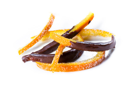 macro image of home made candied orange peel some pieces dipped in chocolate Stock Photo