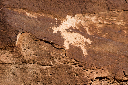 Close up of a Native American petroglyph believe to be Ute in Arches National Park