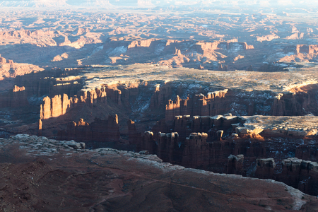 Canyon inside of a larger canyon in Canyonlands NP as the sun sets and glows on the red rocks