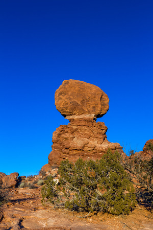 One of the most popular features of Arches National Park, Balanced Rock weighs as much as an Ice breaker ship or 27 blue whales. Photograph with afternoon light