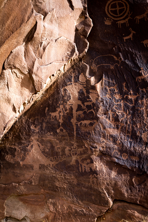 Newspaper rock is a petroglyph panel etched in sandstone that records approximately 2000 years of early human activity with amazing detail. Interpretation is up to the individual as there has not been an official interpretation