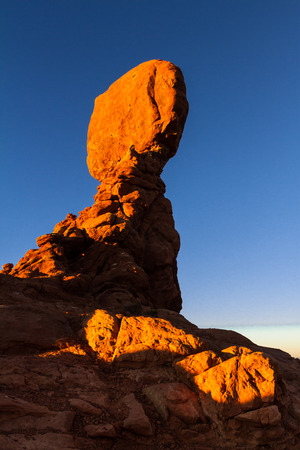 One of the most popular features of Arches National Park, Balanced Rock weighs as much as an Ice breaker ship or 27 blue whales. Photograph with afternoon light white high contrast in the shadow area