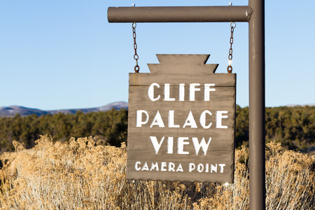 Close up of a sign signaling a great photo opportunity for the Cliff Palace in Mesa Verde NP