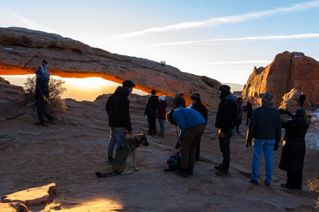 Canyonlands NP, Utah - December 20: Photographers and tourists lined up for sunrise views at Mesa Arch. December 20 2018, Canyonlands NP, Utah Editorial