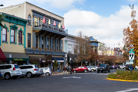 Ashland, Oregon - September 30: People walking to the shops with vehicles parked on the streets. September 30 2018, Ashland, Oregon