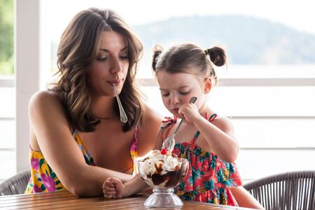 mother and daughter sharing a large ice cream sundae in Coeur d Alene Idaho