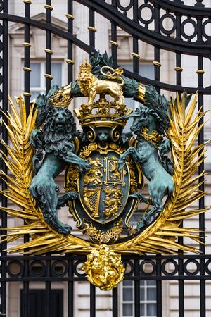 London  - September 06 2019: Close up of the Royal Coat of Arms on the front gates of Buckingham Palace, London September 06,  2019 Sajtókép