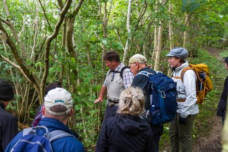 Perthshire Scotland  - September 11 2019: Walk guide explaining Scottish culture to a group of tourists in the Scottish Highlands, UK September 11,  2019