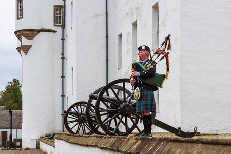 Pitlochry Scotland - September 12 2019: Stuart the piper performing outside of Blair Castle in the Scottish Highlands, Perthshire UK September 12, 2019 Editorial