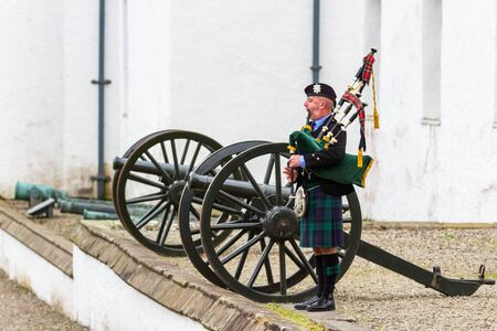 Pitlochry Scotland - September 12 2019: Stuart the piper performing outside of Blair Castle in the Scottish Highlands, Perthshire UK September 12, 2019