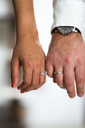 close up of the hands of a couple wearing their wedding bands