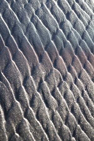 Pattern left behind on the wet sand as the tides change adding beautiful and unique details and a colorful band thru the middle form the sunlight