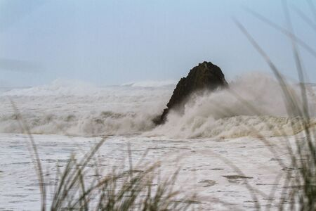 rough seas as the seasonal winter storm approaches the southern Oregon coast, creating high tides and powerful waves