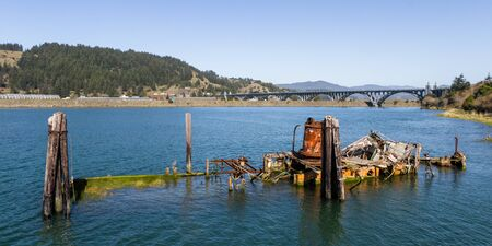 A steamer build in 1881 in Gold Beach now resting in peace in the Rouge River where it sank in 1985 now an important piece of culture and history and a valuable landmark in Gold Beach, Oregon 写真素材