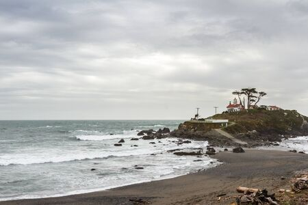 Cloudy afternoon in Crescent City California with a beautiful view of the Battery Point Lighthouse and ocean at low tide
