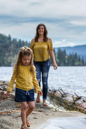 Mother and daughter with matching outfits spending the day at the beach in Coeur d' Alene Idaho