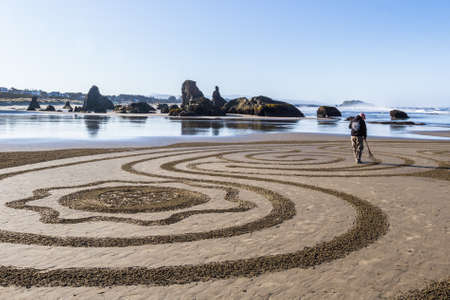 Bandon by the Sea, Oregon / USA - March 13 2020: Detailed artwork created by Denny Dike and the team of Circles in the Sand on the beach of Face Rock State Park