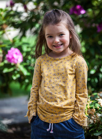 portrait of a happy four year old little girl in a outdoor setting in Coeur d' Alene Idaho, Stok Fotoğraf - 152841992