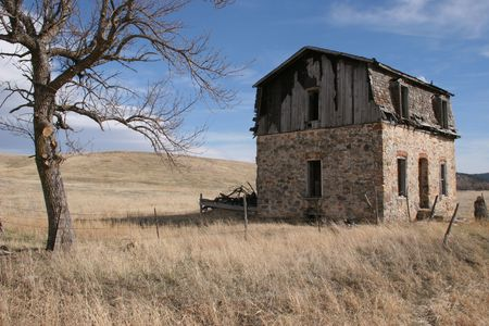abandoned house in a field