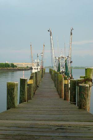 Shrimp boats moored at a dock