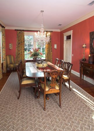expensive diningroom with red walls Stock Photo