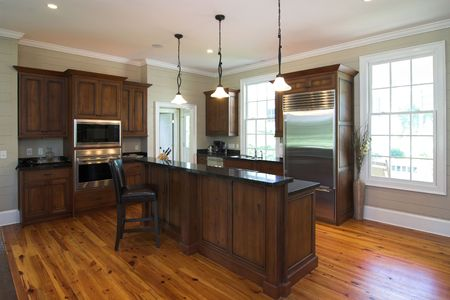 expensive kitchen with dark wood and island