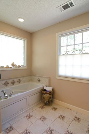 bathroom tile: simple bathroom remode with tile and windows Stock Photo
