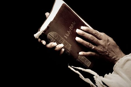 african worship: african american hands holding bible