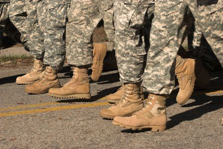 invade: soldiers boots marching in formation