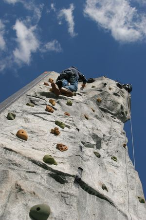 artifical: person climbing artifical climbing wall