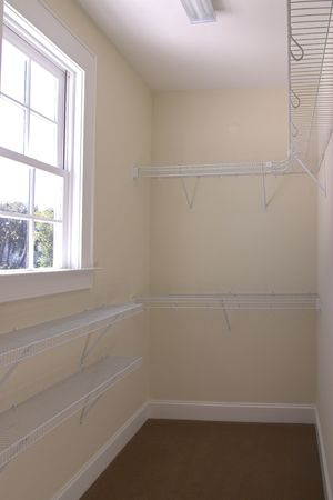 empty walk-in closet with window photo