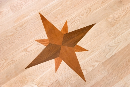 inlaid: compass rose inlaid into wood floor Stock Photo