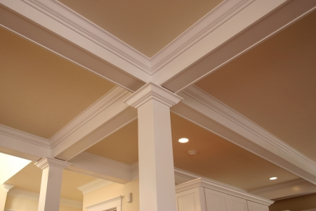 detailed crown molding around pillars and beams