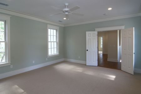 large unfurnished bedroom with double doors photo