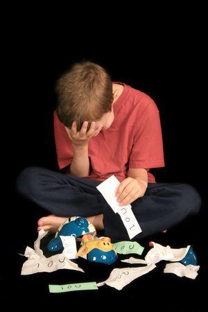 little boy in dispair over finding his bank full of iou's Banco de Imagens