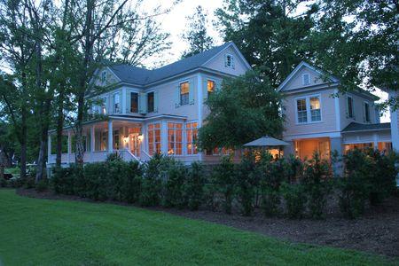 luxurious house exterior at twilight photo