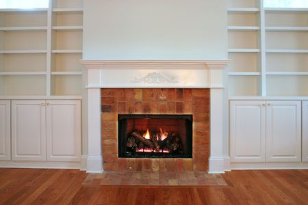 lit fireplace surrounded by reclaimed brick
