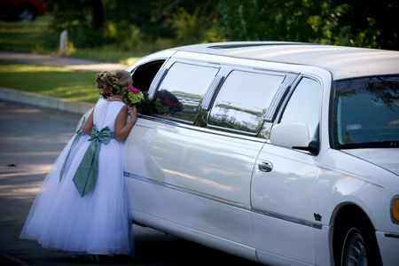 flowergirl: flower girl talking to bride in limo Stock Photo