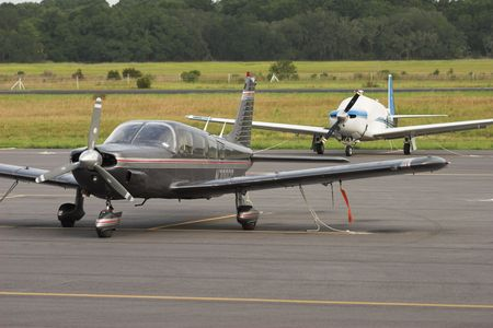 small planes parked on runway
