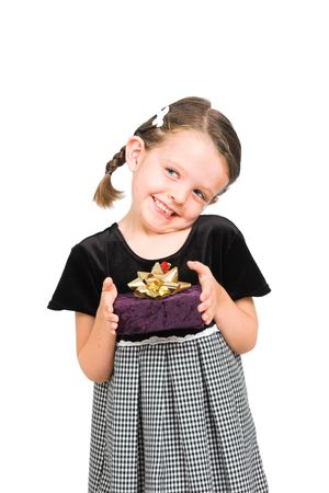 little girl thrilled to be giving gift